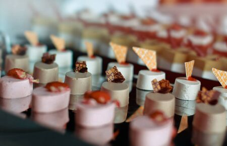 Freshly baked cake, dessert, birthday for Cooks. Decomposition of pieces of the tray. background bokeh Stock Photo