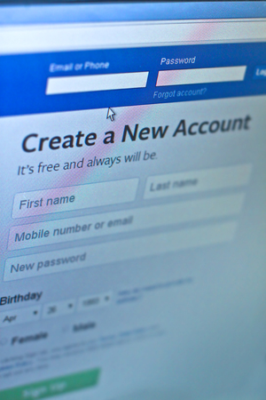 Facebook social media app logo on log-in, sign-up registration page on mobile app screen on smart devices in business person's work official website is 2018 - 2019. Editorial