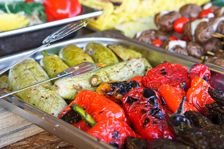 Fried vegetables on the grill with a delicious crust on the background of vegetables. Summer holidays and food in nature. Stock Photo