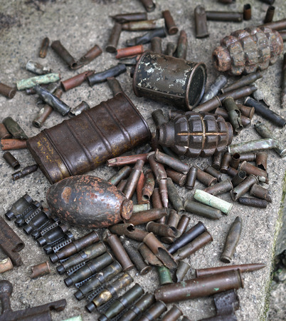 Military background with cartridges of grenades and machine-gun tape. Black archeology. World War II and its artifacts. Great Patriotic War of the USSR Stock Photo