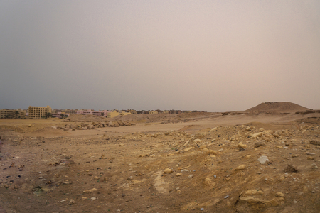 City in the mountainous desert in the Arab region. Ruined city, a poor region. Egypt slums. Stock photography