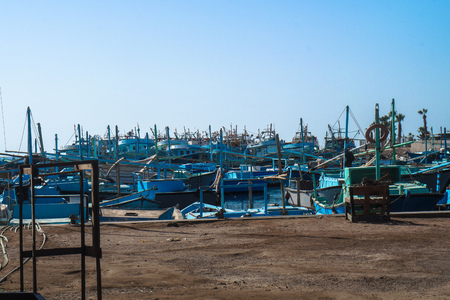 Lots of blue various fishing boats, Fishermen's vehicles in Egypt at the port of the fish market. Stock photos
