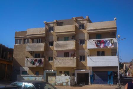 Outdated ruins of houses, slums in poor areas of Egypt. Hurghada and Cairo Asia. Stock photo for design Stock fotó