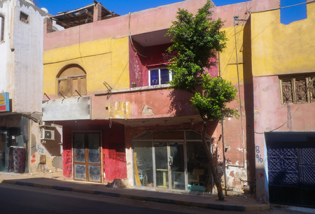 Outdated ruins of houses, slums in poor areas of Egypt. Hurghada and Cairo Asia. Stock photo for design Stock Photo