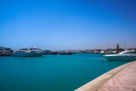 Red Sea, yachts and boats in the port of Egypt. Hurghada and Cairo Asia. Stock photo for design