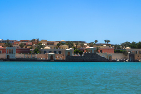 Beautiful view of the coastline with houses and hotels on the red sea. Tourist region in Egypt. Hurghada and its traditions. Stock photo for design