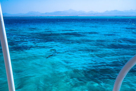 Beautiful blue sea surface with the sky. Oceanic deserted, lonely theme for background. Stock photo for tourist design
