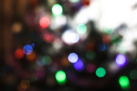 Beautiful Christmas background with garlands and bokeh. New year  multi-colored picture. Abstract photo image for design