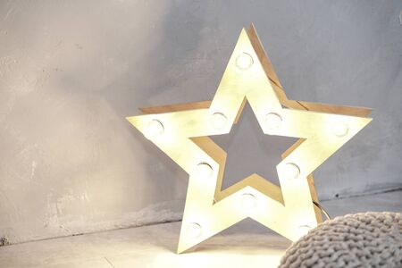 Simple composition with a star that glows. New Year theme Stock fotó