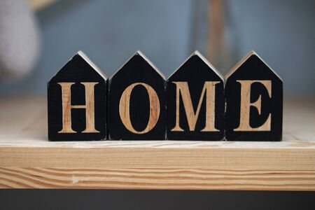Inscription of small black cubes. Home is like a dream and a goal of life. Family comfort.