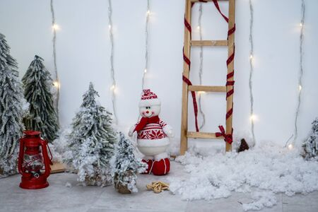 Beautiful Christmas composition with a snowman and a lantern. Stock Christmas theme Imagens