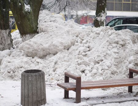 Big abnormal snowfall in the city. Street cleaning and snowdrifts. Snow and collapse of communal services. Stock photo for demonstration