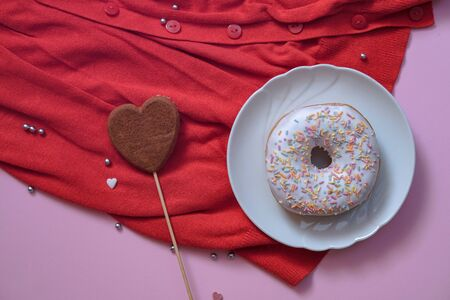 Beautiful juicy donuts with coffee in plates on a decorative tray. February valentines day greeting card. background for kitchen design