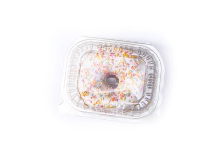 Beautiful juicy donut with a sweet cream. Cupcake on white Background for kitchen design.