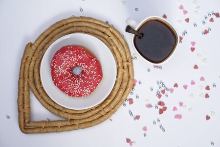 Beautiful juicy donuts with coffee in plates on a decorative tray. Cupcake on a white background for kitchen design. 写真素材