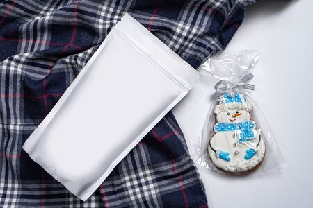 Template of paper ecological bag for storing coffee, tea with snowman-shaped cookies. Vacuum packaging for christmas and new year present