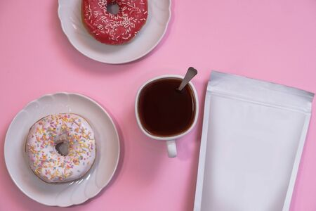 Template of paper ecological bag for storing coffee, tea and donuts with a cup of cappuccino. Vacuum packaging for christmas and new year present