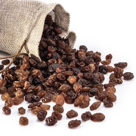 Raisins peeled on a white isolated background. Food grape  brown delicious for your design for the site. kitchen theme