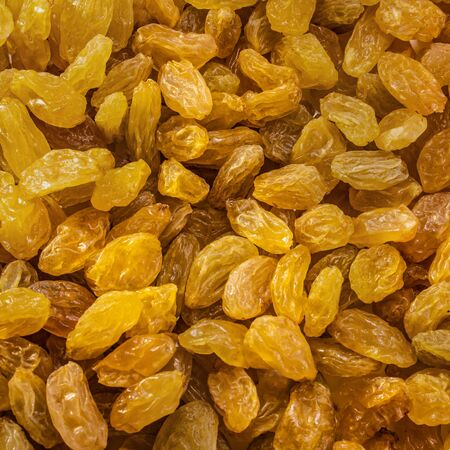 Raisins peeled on a white isolated background. Food grape yellow delicious for your design for the site. kitchen theme