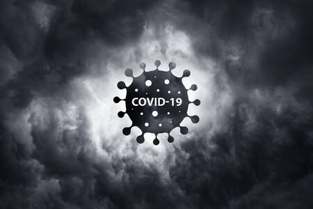 Warning about the scary COVID-19 virus. World pandemic with coronavirus COVID19.  city is a threat to humanity. Bacteria on a background of thunderclouds