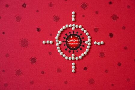 World pandemic with coronavirus and high mortality. Warning about the scary COVID-19 virus. Infections of Asia, Europe and America COVID19. Pills sight and rescue on a red background Archivio Fotografico