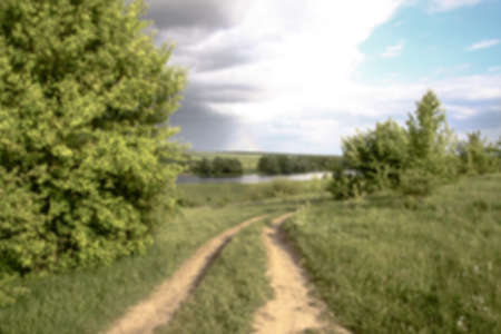 Field in the road among the hills. Landscape in nature in the reserve in the park. Stock photo background