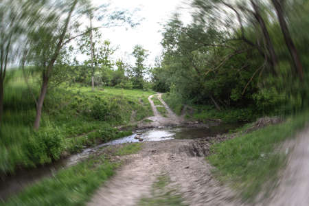 Off-road outside the village. impassable swamp on the way to the city. Earth texture in water for design.
