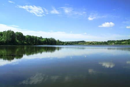 Beautiful river in a pretty area in Siberia. Landscape in Canada with a cold lake. Stock photo background. Фото со стока