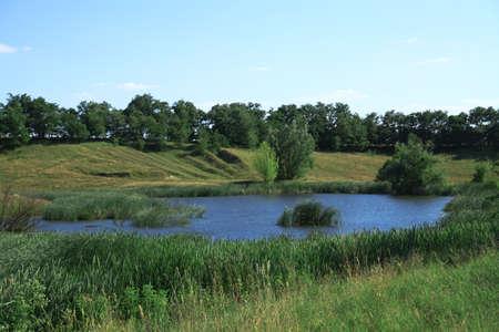 Beautiful river in a pretty area in Siberia. Landscape in Canada with a cold lake. Stock photo background. Banco de Imagens