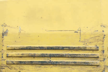 Yellow metal texture rusting becomes worthless. Scratched background for grunge design. Stock photo