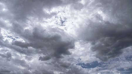 Picturesque clouds in the sky. Window view of an airplane on a sunny gloomy day. Stock photo background