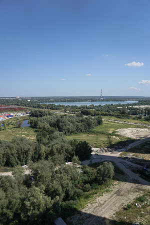 Outskirts of the city industrial zone on the background of a river or lake. Stock photo for design