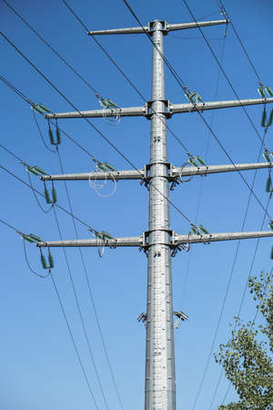 High voltage pole with wires through which electricity flows. Power lines and substations for nuclear power plants. Industrial theme for design