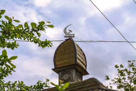 Arbor of the times of the ussr. Gazebo. Coat of arms on the roof in Ukraine or Russia
