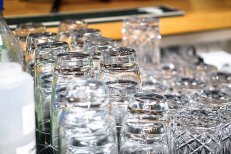 Clean washed glasses of dishes in the kitchen. Glasses for a large company