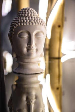 Sculpture of a bust of a Buddha. Eastern god in Buddhism. India and Sri Lanka beliefs 版權商用圖片