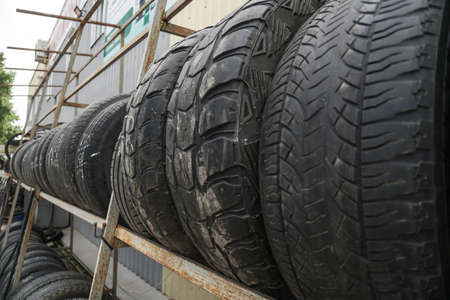 Used car tires at a recycling plant. wheels for trucks. Background for environmental theme Stock fotó - 160747961