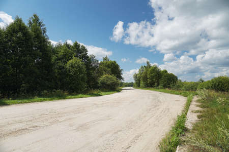 Large dirt road outside of civilization. Road In Russia in Siberia. Nature stock background