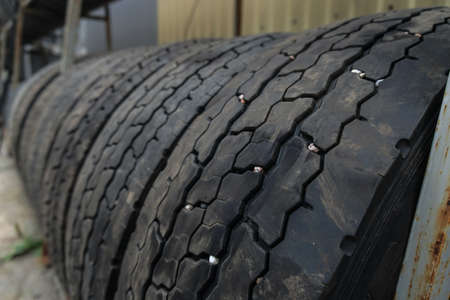 Used car tires at a recycling plant. wheels for trucks. Background for environmental theme