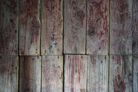 Old board in erased paint. Wooden wall of an old building. Background for design. 스톡 콘텐츠