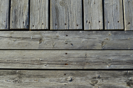 silvery: Silvery worn wood planks run both horizonally and vertically as a background with character