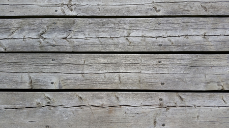 silvery: Silvery worn wood planks run horizonally as a background with character. Taken from above
