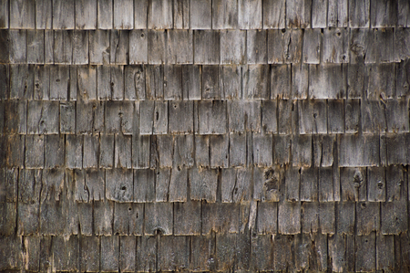 cedar shakes: A whole wall of very weathered cedar shakes on the side of an old outbuilding