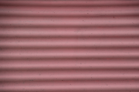 Image is filled with pink and white striped undulated curvy waves from a harborside warning sign. Imagens