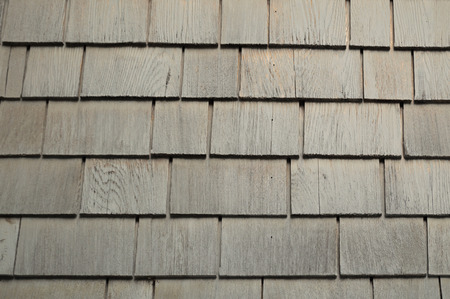 Neat. tidy. newer grey cedar shakes shingles background