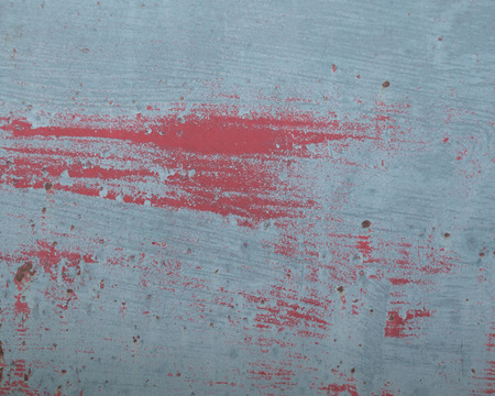 Faded peeling rusty steel sheets with oxblood red paint. Grunge, distressed, weathered and worn, old fuel tank.