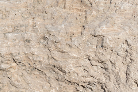 Closeup limestone rock face showing weathered strata for a greologival, natural wallpaper or backdrop