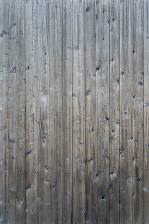 Weathered gray raw woodenboards and planks background wallpaper Stock Photo