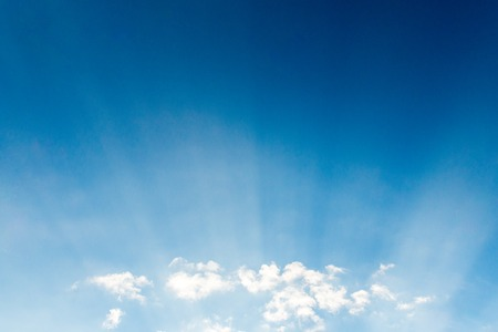 Blue sky cloudscape and white clouds background with sunbreams Stock Photo