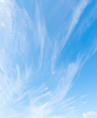Blue sky cloudscape with white cirrus cloud background Stock Photo